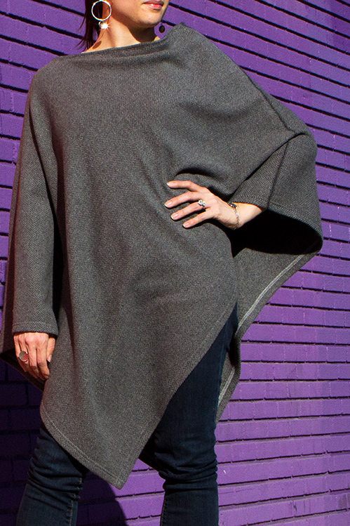 A warm gray poncho in woven cashmere for spring or fall.
